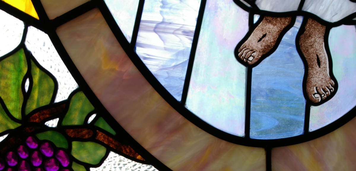 feet of Jesus in stained glass